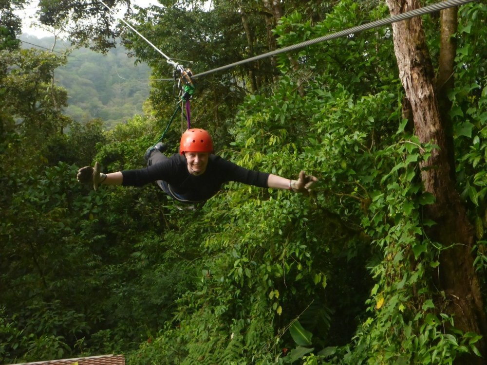 I'm arriving at the end of the longest Superman zip line cable in Latin America!