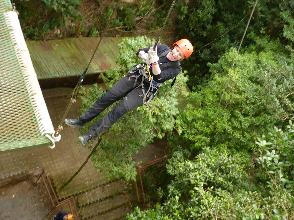 Jumping off the rappel platform with a crazy look on my face.