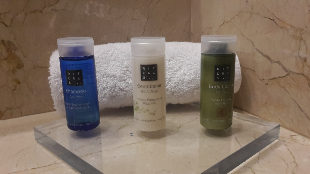 Three Rituals-brand amenity bottles in a hotel bathroom