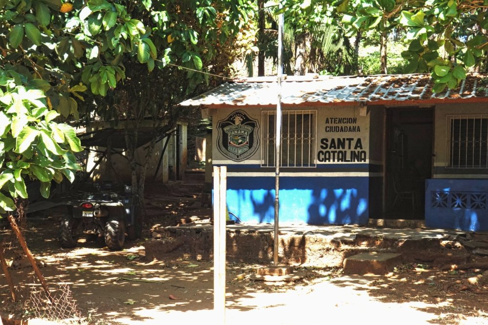 Santa Catalina police station, shaded under trees, an ATV parked to the left.