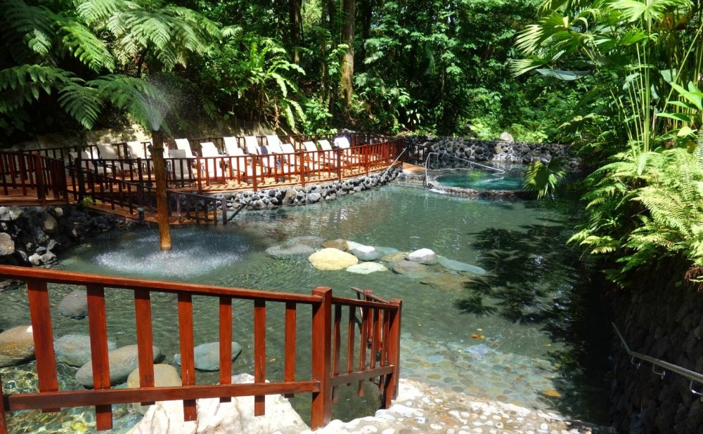 Eco Termales hot springs completely empty, surrounded by lush green.