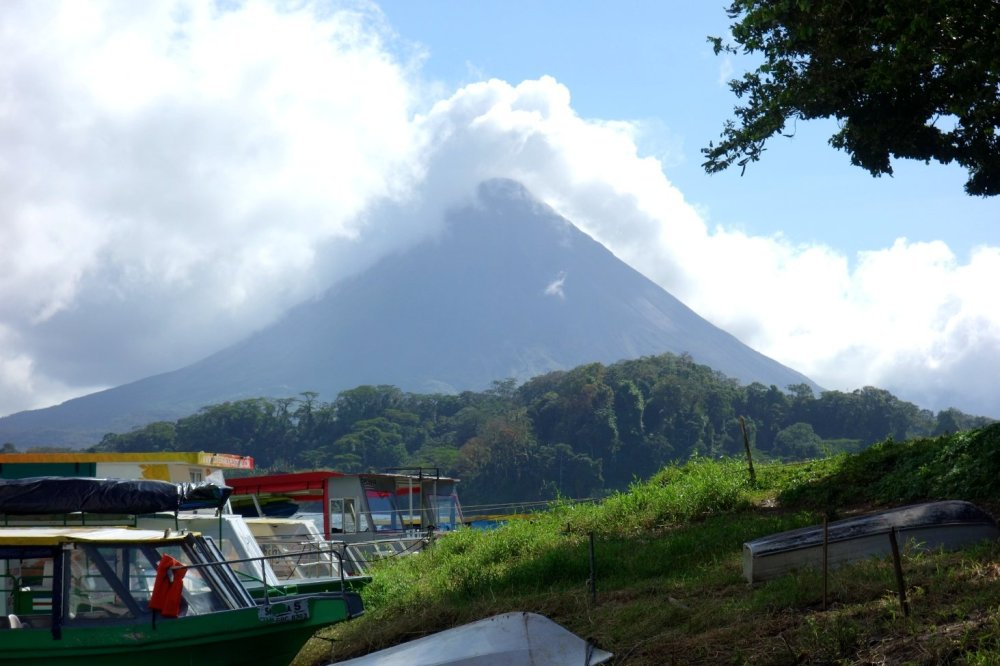 Volcano Arenal seen across Lake Arenal, La Fortuna